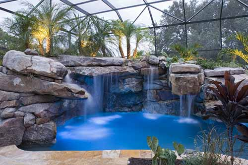 Massive Natural Stone Grotto Waterfall and Spa | Inground Pool Lights